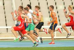 Competitors on start of 100m Stock Photos
