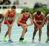 Athletes on the start of 10000 event Stock Photos