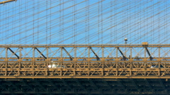 Brooklyn bridge detail side view cars and pedestrians sky New York City NYC - stock footage