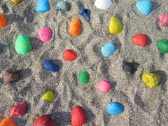 Scattering of colored shell in the sand Stock Photos