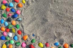 Abstract background with seashells in the sand - stock photo
