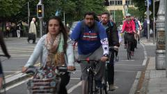 People cycle home from work on cycle path, city centre, Dublin, Ireland Stock Footage