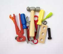 A lot of children's toy instruments gathered in a pile, bright colored Stock Photos