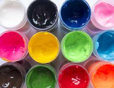 View milestone on open packages of multi-colored paint Stock Photos