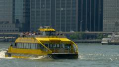 Tourists sightseeing by Water Taxi in East River Manhattan New York City NYC Stock Footage