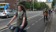 People bicycle home from work on cycle path, city centre, Dublin, Ireland - stock footage