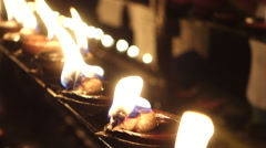 Oil candles burning - stock footage