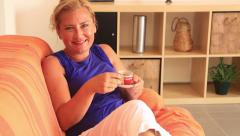 Woman drinking espresso and smiling to camera Stock Footage