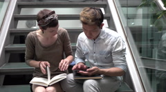 Multicultural students learning with books and tablet - stock footage