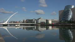 River Liffey, Samuel Becket Bridge and the conventional Centre, Dublin, Irela Stock Footage