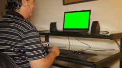TALKING TO FAMILY on laptop computer green screen - stock footage