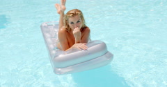Woman Lying on Floating Mattress in the Pool Stock Footage