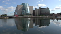 Reflection of Conventional Centre tilting building on River Liffey, Dublin Stock Footage