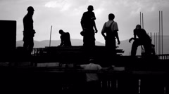 4K, Black and White shot of construction workers Stock Footage