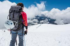 Stock Photo of Female alpinist enjoying the view.