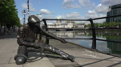 The Linesman statue and Custom House, River Liffey, Dublin, Ireland Stock Footage