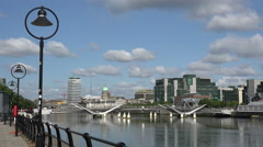River Liffey, Sean O'Casey Bridge and buildings, Dublin, Ireland Stock Footage
