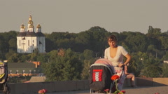 Stock Video Footage of mother with a stroller, panorama