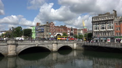 Traffic and people cross Oconnell street bridge, River Liffey, Dublin Stock Footage