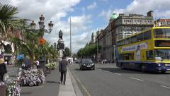Buses and cars cross Oconnell street bridge, River Liffey, Dublin, Ireland Stock Footage