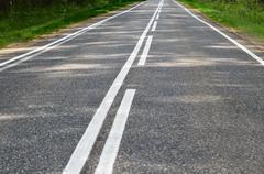 Asphalt road with a white marking Kuvituskuvat