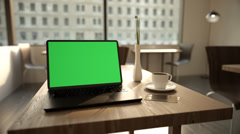 Laptop And A Cup Of Coffee On A Table Stock Footage