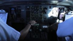 Pilots operating controls of a plane during the flight. Stock Footage