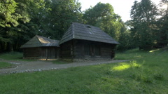 Two wooden houses in Astra National Museum Complex, Sibiu Stock Footage