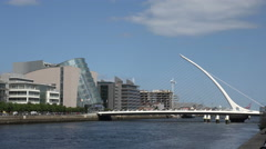River Liffey, Samuel Becket Bridge and conventional Centre, Dublin, Ireland Stock Footage