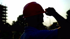 4K, Construction worker wiping the sweat of his forehead - stock footage