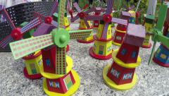 Kinderdijk toy color mills for sale and real windmills in the background 4k Stock Footage