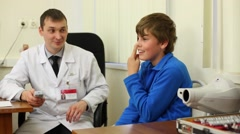 Boy checks eyesight at the reception of an ophthalmologist. Stock Footage