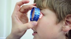 Hand of ophthalmologist with lens and boy face. Oculist examine eye Stock Footage