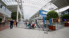 Stock Video Footage of Buyers and visitors in megamall with advertisement of shops