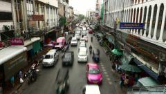 Inner-city road traffic jam gathering, timelapse shot from top point Stock Footage