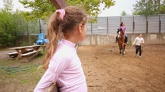 People take horse riding lessons in stable Elk Island. Stock Footage
