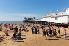 Stock Photo of Weston-super-Mare beach and pier Somerset with tourists and visitors summer