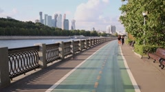 Painted in green marked bikeway on river embankment. Stock Footage
