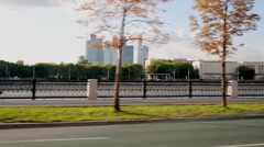View from window of quickly riding car on embankment and buildings Stock Footage