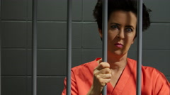 Female inmate in jail cell Stock Footage