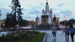 People walk near fountain Friendship of Peoples at VDNKh. Stock Footage