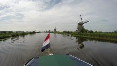 Dutch flag on a boat on a canal in Kinderdijk Childrens Dike windmills Unesco 4k Stock Footage