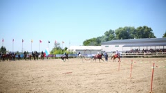Horsemen jumping through a ring of fire and ride around the arena Stock Footage
