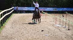 A man stands on backs of horses at Championship for Dzhigitovka Stock Footage