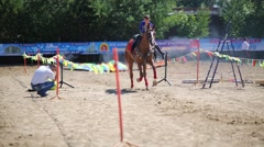 The riders jumping over a burning bar at Championship for Dzhigitovka Stock Footage