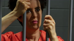 Female inmate in jail cell, close up shot - stock footage
