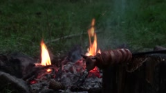 Campfire with sausage Stock Footage