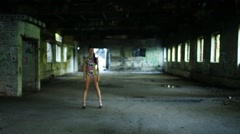 Go-go dancer in an abandoned building comes and poses Stock Footage
