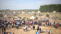 Stock Video Footage of The campground and visitors at military festival Battlefield.