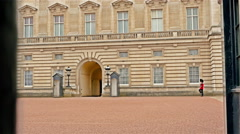 Queen's Guard marches while on duty at Buckingham Palace, London Stock Footage